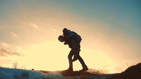 Father and daughter teamwork happy family tourists silhouette concept rides on his back funny video . team dad and. Daughter on sunset play dabble top of the stock footage