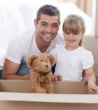 Father and daughter with a teddy bear moving home royalty free stock photography
