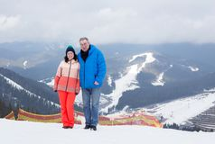 Father and daughter at the top of the mountain. Royalty Free Stock Images