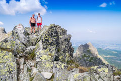 Father and daughter on the top of the mountain Royalty Free Stock Image