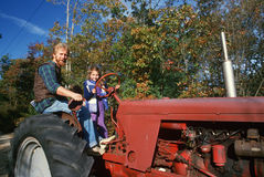 A father and daughter on a tractor, Royalty Free Stock Photography