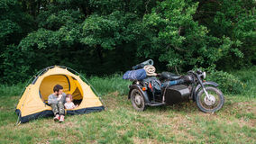 Father and daughter travel on motorbike to camping Royalty Free Stock Images