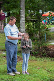 Father and Daughter Trout Fishing. 32nd Brethren Heritage Celebration, Fincastle, VA – October 1st: Father teaching his daughter how to fish for trout at royalty free stock images