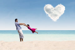 Father and daughter under heart cloud Royalty Free Stock Photos