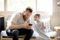 Father Daughter Using Devices Concept Stock Photo