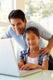 Father and daughter using laptop Royalty Free Stock Image