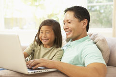 Father And Daughter Using Laptop At Home Stock Image