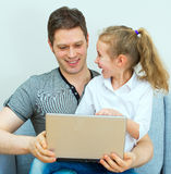 Father and daughter using notebook. Royalty Free Stock Photography