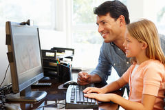 Father and daughter using skype in home office Royalty Free Stock Images