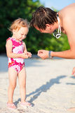 Father and daughter on vacation. Little girl and her father on tropical beach stock photo