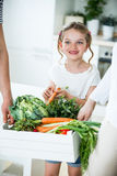 Father and daughter with vegetable box in kitchen Royalty Free Stock Photo