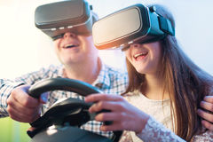 Father and daughter in virtual reality glasses playing video game Stock Image