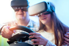 Father and daughter in virtual reality glasses playing video game Stock Photos