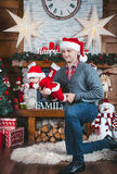 Father and daughter wait for Christmas. Christmas time. Father abd daughter in the New Year decorations Stock Photos