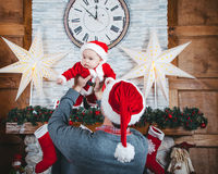 Father and daughter wait for Christmas. Christmas time. Father abd daughter in the New Year decorations Royalty Free Stock Photography