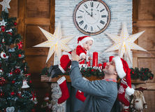 Father and daughter wait for Christmas. Christmas time. Father abd daughter in the New Year decorations Royalty Free Stock Photo