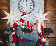 Father and daughter wait for Christmas. Christmas time. Father abd daughter in the New Year decorations Royalty Free Stock Photos