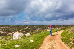 Father and daughter walk along the path along the sea. Beautiful valley by the sea. Seascape in Cyprus Ayia Napa stock photos