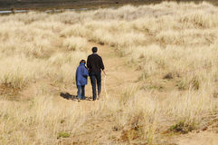 Father and daughter on walk in countryside. Portrait of father and daughter on walk in countryside stock photography