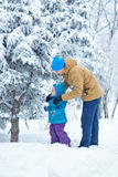 Father and daughter walk in deep snow. Royalty Free Stock Photo