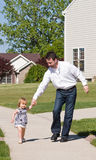 Father and Daughter Walking Royalty Free Stock Photos