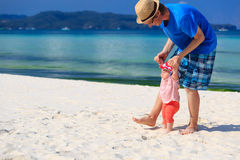 Father and daughter walking on the beach Royalty Free Stock Photos