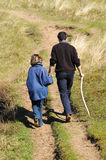 Father and daughter walking in countryside. Portrait of father and daughter on a walk stock photo