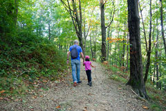 Father and daughter walking in the forest Stock Photo