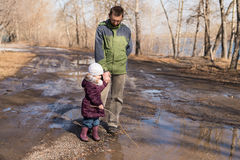 Father and daughter walking in the forest Royalty Free Stock Photo