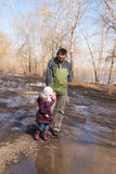 Father and daughter walking in the forest Stock Photography