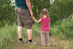 Father and daughter walking on a hill Royalty Free Stock Image