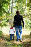 Father and daughter walking in park Stock Photos
