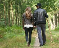Father and daughter walking on path in the woods Stock Photography