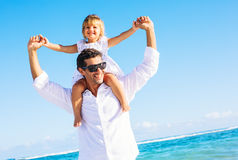 Father and daughter walking together at the beach Royalty Free Stock Image