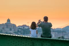 Father and daughter watch cityscape royalty free stock photo