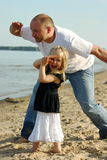 Father and daughter watching s Royalty Free Stock Images