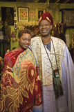Father and daughter wearing African clot. Portrait of smiling mid-adult African-American man and his young adult daughter wearing traditional African clothing Royalty Free Stock Photos