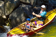 Father and daughter in a whitewater canoe Royalty Free Stock Photos