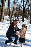 Father and daughter in winter park Stock Photography