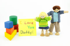 Father and daughter wooden toys with card Stock Photo
