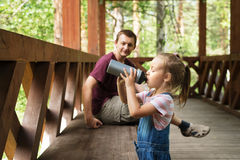 Father and daughter in the woods Royalty Free Stock Photography