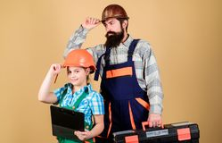Father and daughter in workshop. Bearded man with little girl. construction worker assistant. Builder or carpenter royalty free stock images