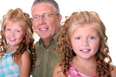 Father with daughters. Mature father and two daghters - close up Royalty Free Stock Photos