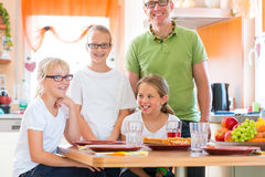 Father and daughters in kitchen eating healthy Royalty Free Stock Photography