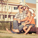 Father and daughters playing near the house at the day time. Royalty Free Stock Photo