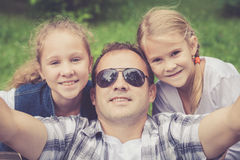 Father and daughters  playing at the park at the day time. Stock Images