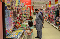 Father and daughters shopping in Hyperstar Supermarket. Stationary Items at Hyperstar Supermarket, Emporium Mall, Lahore Pakistan Royalty Free Stock Photo
