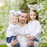 Father and daughters wearing bunny ears on Easter Royalty Free Stock Images