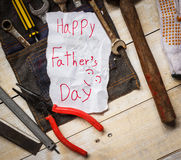 Father day card. Father day paper card with tool from kid on wood stock photos