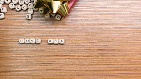 Father Day celebration on wood background top view. The Father Day celebration on wood background top view royalty free stock photography